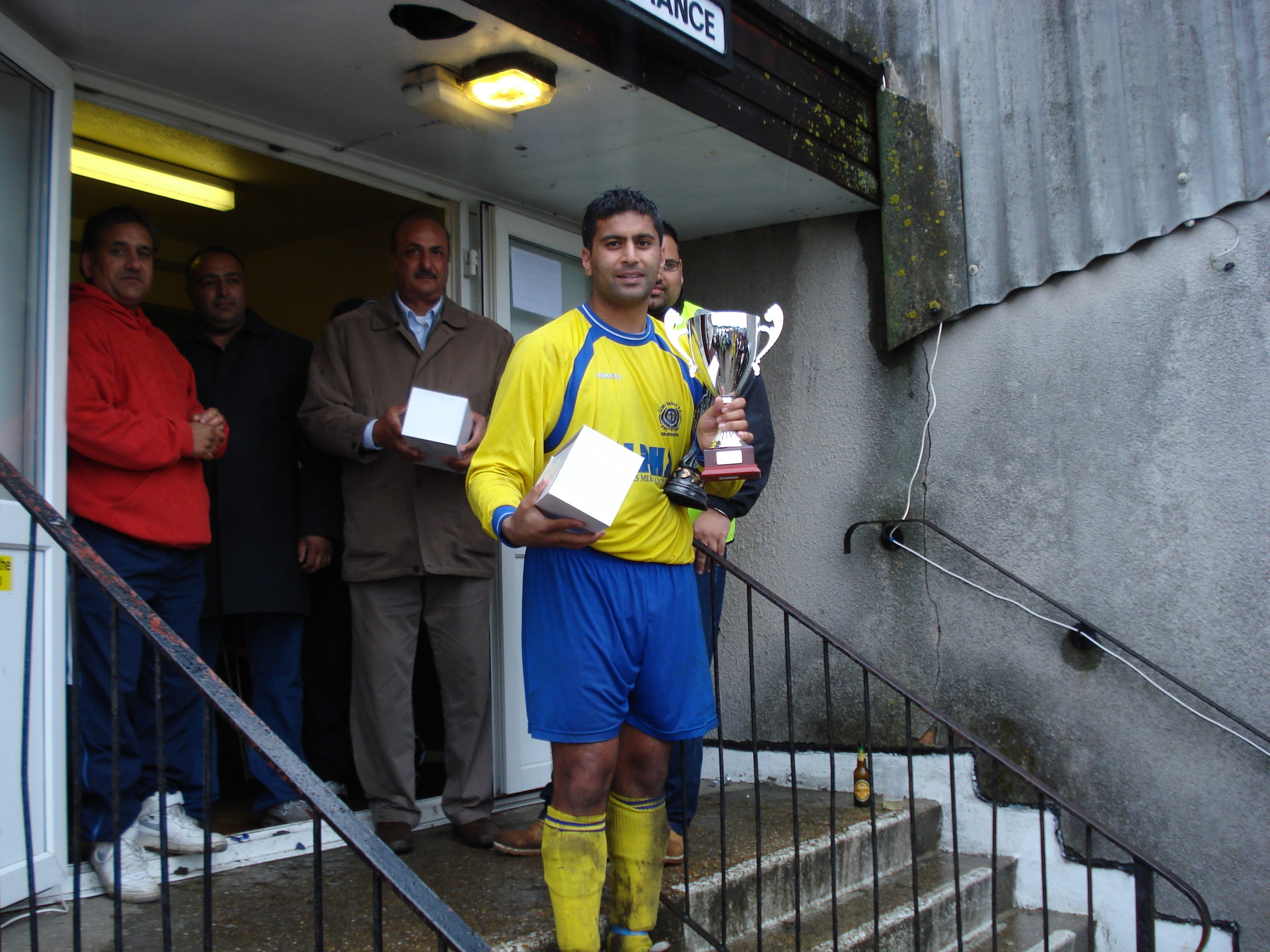 Kam With The Premier Division Trophy