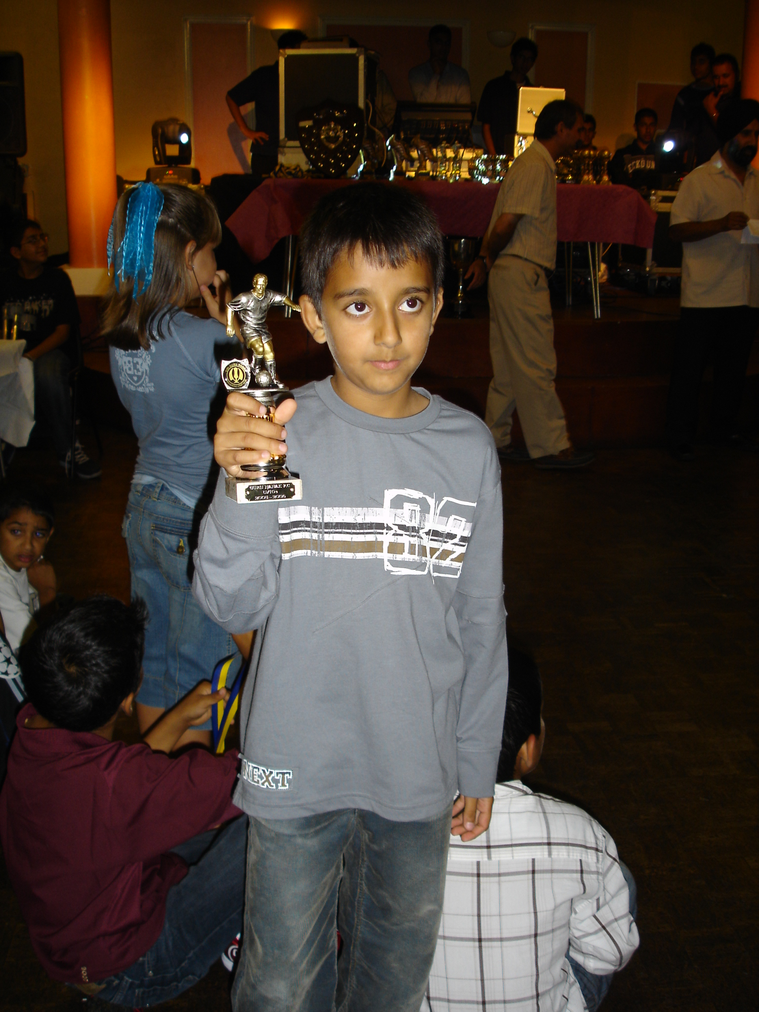Little Arron Bains with his trophy – he is the one on the right!