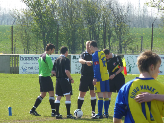 Captain Reece shakes hands with the Referee