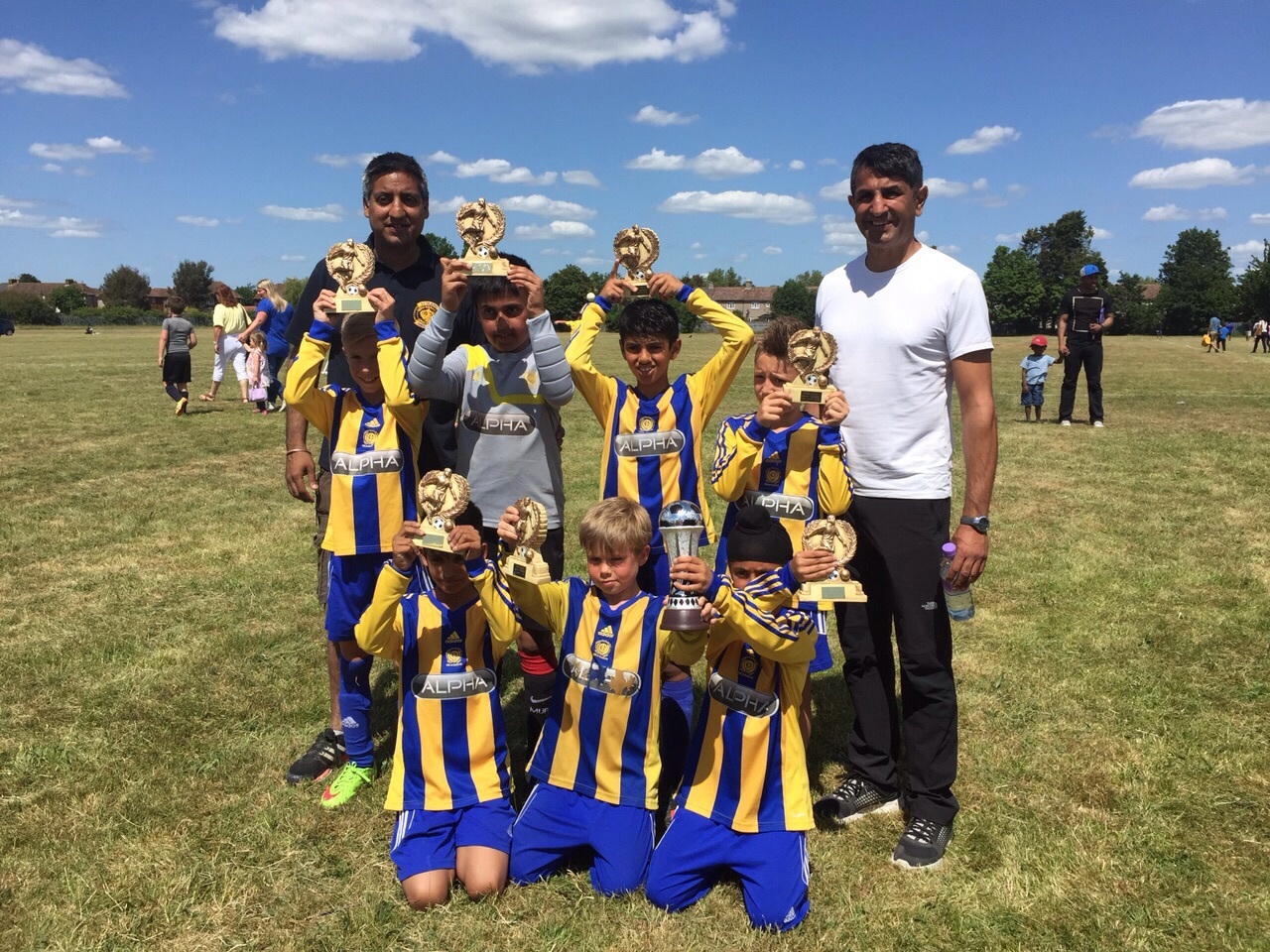 Under 9s Winners with managers Harpal & Jess